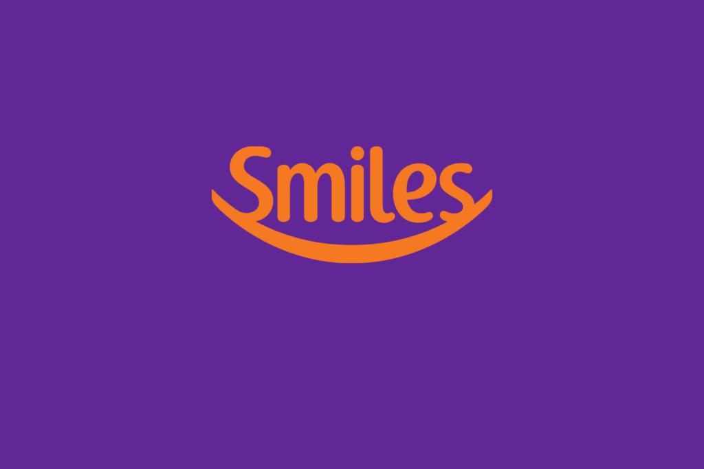 Logo do programa de fidelidade em laranja e roxo